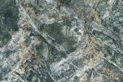 Surface grey granite stone with light lines and streaks. stock photography
