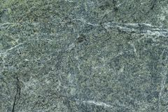 Surface grey granite stone with light lines and streaks. stock images