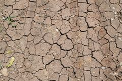 Surface of a grungy dry cracking parched earth stock images