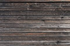 Surface of a heavily weathered planking of a facade made of wooden slats royalty free stock photo