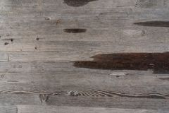 Surface of a heavily weathered wooden bench in the park, with larger water spots royalty free stock image
