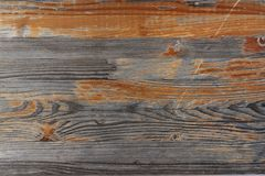 Surface of a heavily weathered wooden bench in the park, with partially peeled paint stock image