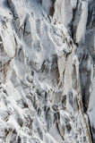 Surface hoar ice crystals formed on rockface in winter Stock Photos