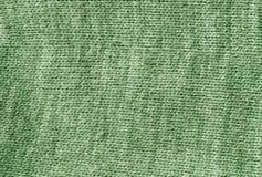 Surface knetted de tissu de couleur verte Photographie stock