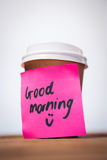 Surface level of good morning text stuck on disposable cup Royalty Free Stock Images