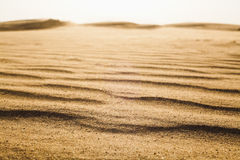 Surface level shot of the desert and the wind pattern on the sand Royalty Free Stock Image