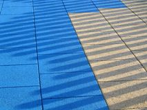 Surface Lines. Long shadows cast on a playground area Stock Images