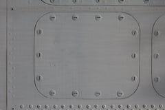 Surface métallique avec l'écoutille photographie stock libre de droits
