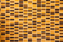 Surface of Mosaic in ancient style stacked with tiny brown, yell Royalty Free Stock Image