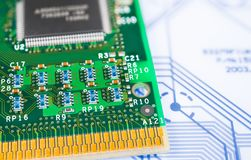 Surface-mount technology. Green circuit board. Old computer processor detail stock photography