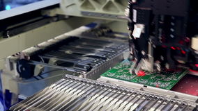Surface Mount Technology Machine places elements on circuit boards stock video footage