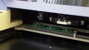 Surface Mount Technology Machine places elements on circuit boards stock video