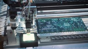 Surface Mount Technology Smt Machine places elements on circuit boards stock footage