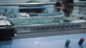 Surface Mount Technology Smt Machine places elements on circuit boards stock video footage