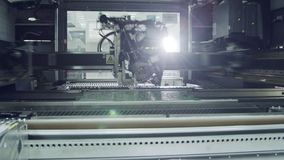 Surface Mount Technology SMT Machine places components on a circuit board
