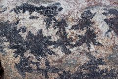 Surface of natural   black and dark red stone Royalty Free Stock Photo