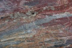 Surface of natural  dark red stone as background Royalty Free Stock Photography