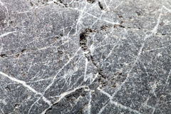 The surface of natural stone as a natural background. Selective Royalty Free Stock Photography