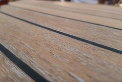 The surface of the new teak deck. Radial cutting of wood. Selective focus royalty free stock photos