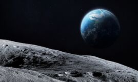 Free Surface Of The Moon. Craters. Planet Earth On The Dark Background Royalty Free Stock Images - 187942119