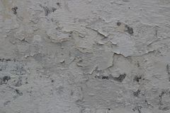 Shabby wall with bristling paint. Texture for design. The surface of the old, cracked wall. Applicable in the design of the exterior or interior royalty free stock image