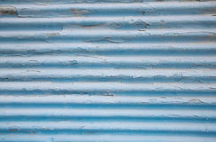 Surface of an old painted blue tin background with panels. Stock Photo