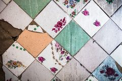 Surface of the old and partly damaged square tiles Royalty Free Stock Photography