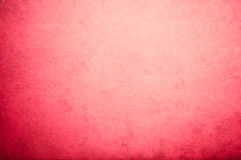 Surface of old red paper. With circular gradient Stock Photo