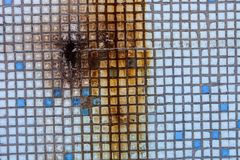 Surface of the old small square tiles with rust Royalty Free Stock Photo