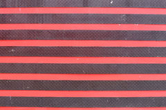 Surface of the old steel doors black and red color. Royalty Free Stock Image