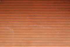 Surface of the old steel doors orange. Royalty Free Stock Image