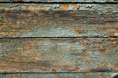 Surface of an old wooden wall with peeling paint Royalty Free Stock Photos