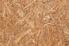 The surface of the oriented particle Board, pressed from a long strand. The technology of oriented layer-by-layer stacking of long chips is applied. Material stock image