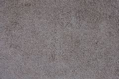 Surface of painted grainy grayish pink wall. Surface of painted grainy greyish pink wall Stock Photography