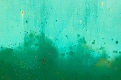 Surface peinte par métal vert avec la peinture de jet Texture de fond photographie stock libre de droits