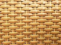 Surface of plastic woven in brown, background and texture. Technique used in the elaboration of objects of mexican handicraft, design and geometric style royalty free stock photography