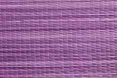 Surface pourpre de tapis de paille de couleur Photo stock