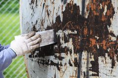 Surface preparation by trowel for remove old paint Royalty Free Stock Images