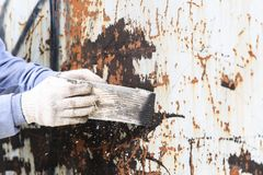 Surface preparation by trowel for remove old paint Royalty Free Stock Photos