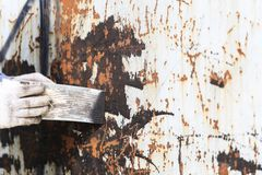 Surface preparation by trowel for remove old paint Stock Images