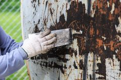 Surface preparation by trowel for remove old paint Royalty Free Stock Photo