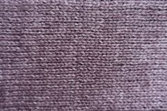 Surface of puce basic knitted fabric. From above Stock Photos