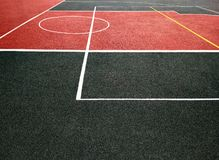 Red and black sports field. Surface of red and black sports field with white lines. Playing ground for games stock photo