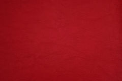 Surface of red leatherette texture for background. Royalty Free Stock Image