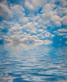 Surface Rippled of water with clouds and sky background Royalty Free Stock Photography