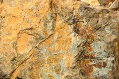 Surface of the rock as a background. Surface of the mountain rock as a background stock photo