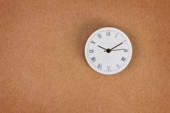 Surface of roman number clock on brown paper background Royalty Free Stock Photography