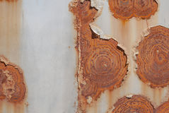 Surface of rusty iron with remnants of old paint, grunge metal surface, texture background Stock Image
