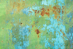 Surface of rusty iron with remnants of old paint texture background Stock Images