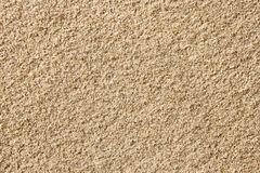 Surface with small yellow sand Royalty Free Stock Photo